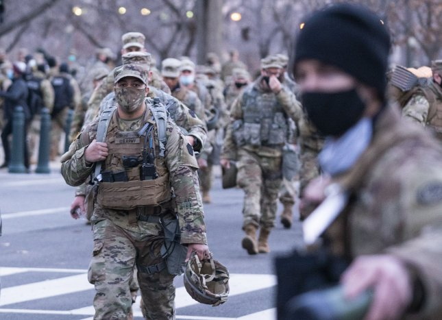 Members of the National Guard patrol near the U.S. Capitol as they help provide security for the upcoming inauguration of President-elect Joe Biden in Washington, D.C., on Monday. Photo by Kevin Dietsch/UPI