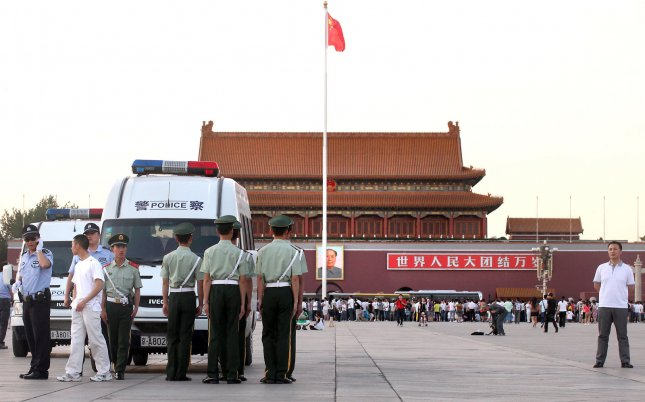 Chinese police and soldiers patrol Tiananmen Square in central Beijing on June 3, 2011. UPI/Stephen Shaver