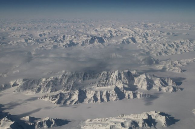 MIT researchers say that roughly 50 million years ago, as India collided with Eurasia, a large oceanic rock known as the Nidar Ophiolite was pushed onto dry land. It's exposure to tropical weather triggered chemical reactions that sucked large amounts of CO2 from the atmosphere, triggering an ice age. Pictured, Greenland's massive ice sheet from 40,000 feet aboard NASA's G-III aircraft on March 26, 2016. File photo by NASA/UPI