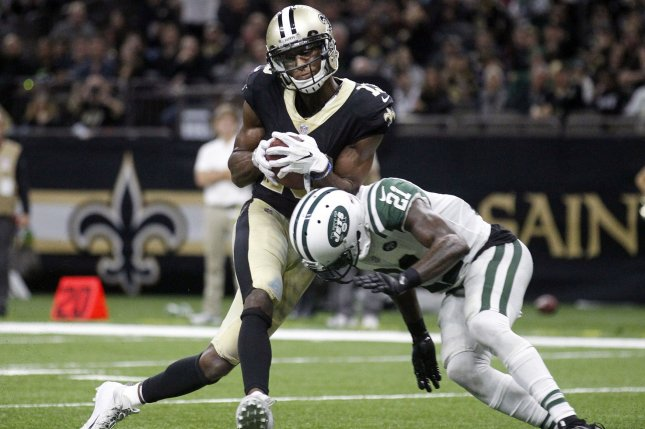 New Orleans Saints wide receiver Michael Thomas (13) catches a four-yard Drew Brees pass in front of New York Jets cornerback Morris Claiborne (21) for a touchdown on December 17, 2017 at the Mercedes-Benz Superdome in New Orleans. Photo by AJ Sisco/UPI