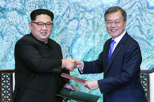 South Korean President Moon Jae-in (R) and North Korean leader Kim Jong Un announce the Panmunjom Declaration at the Peace House in Panmunjom in Paju, South Korea, on Friday. It was the first time a North Korean leader had crossed the border since the Korean War began. Photo by Inter-Korean Summit Press Corps/UPI
