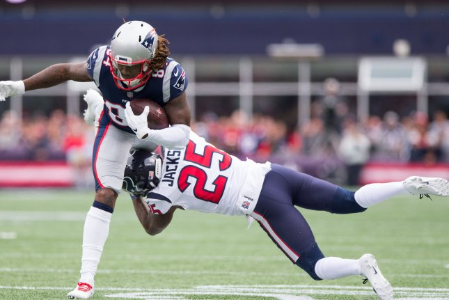 New England Patriots wide receiver Cordarelle Patterson (84) is tackled by Houston Texans safety Kareem Jackson (25) on a three-yard reception in the first quarter at Gillette Stadium in Foxborough, Massachusetts on September 9, 2018. Photo by Matthew Healey/UPI