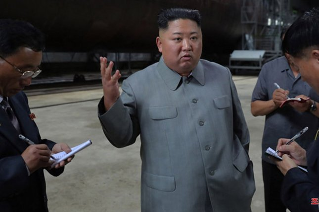 This image, released on July 23 by the North Korean Official News Service (KCNA), shows North Korean leader Kim Jong Un inspecting a newly built submarine. File Photo by KCNA