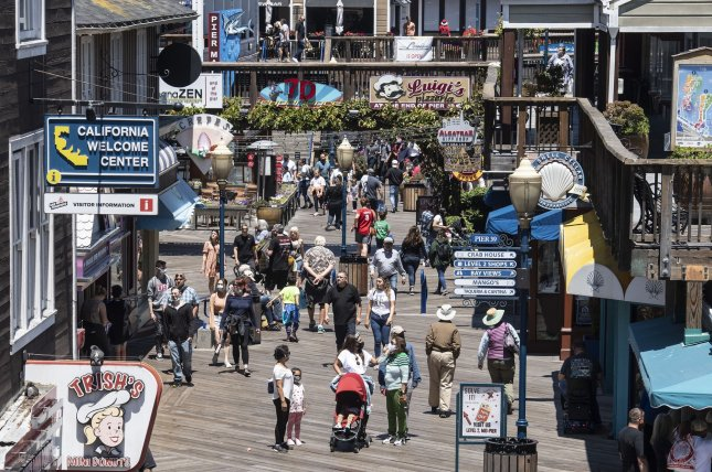 Summer crowds flock to Pier 39 in Fisherman's Wharf in San Francisco on Tuesday as California lifts restrictions on social distancing, capacity and mask wearing for vaccinated individuals in most situations after 15 months of lockdown. Photo by Terry Schmitt/UPI