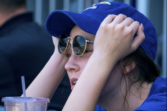 A Kansas City Royals fan reacts to the heat and long game against the Detroit Tigers at Kaufman Stadium in Kansas City, Missouri on Wednesday. Photo by Kyle Rivas/UPI