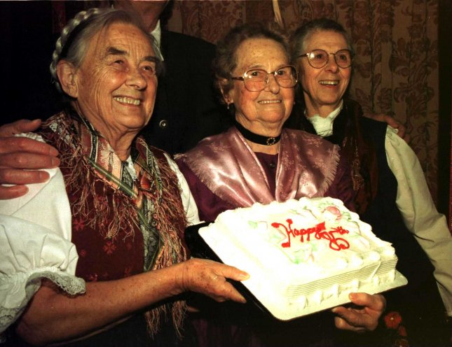 NYP98031305 - 13 MARCH 1998 - NEW YORK,NEW YORK,USA: The Von Trapp sisters Maria (left) and Rosmarie (right) help celebrate Agathe 85th birthday,March 12th with a surprise birthday cake at opening night festivities at the Martin Beck theatre for the broadway revival of Sound of Music. UPI ep/Ezio Petersen