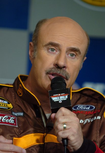 Dr. Phil McGraw talks to the media about the U.S. Marine Corps Reserves Toys for Tots program prior to the NASCAR Dickies 500 at Texas Motor Speedway in Ft. Worth, TX on November 5, 2006. The McGraw teamed up with NASCAR to help raise awareness of the program. (UPI Photo/Ian Halperin)