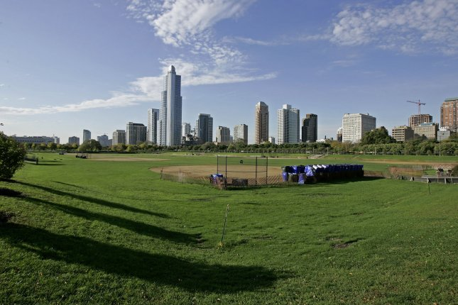 Better signs cheap way to increase exercise in public parks. From the northeast corner of Hutchinson Field looking southwest, high-rise condos tower over Grant Park in Chicago. The park, located between Chicago's central business district and the Lake Michigan shore, hosted a papal visit by John Paul II in 1979, and routinely hosts open-air concerts, sporting events and the Taste of Chicago. (UPI Photo/Brian Kersey)