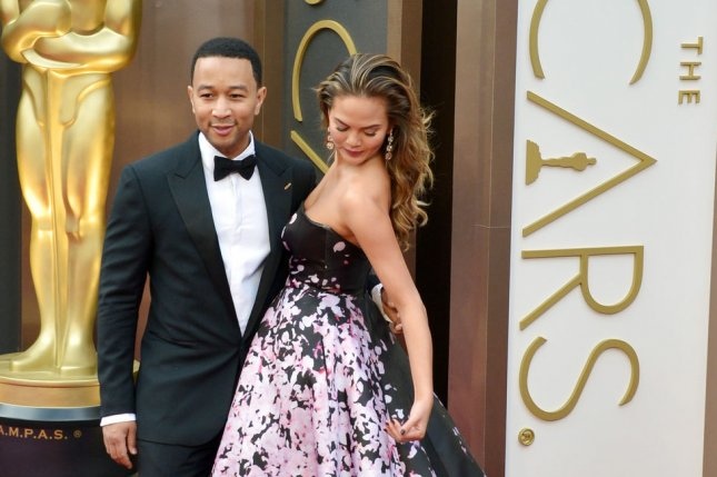 Chrissy Teigen and John Legend hired food trucks to deliver free food for NYC protesters on Dec. 7. UPI/Kevin Dietsch