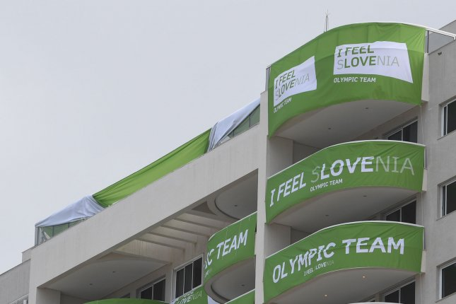 Banners cover the decks of the Slovenia Olympic Team Friday at the Athletes Village in Rio de Janeiro. The Australian Olympic team was robbed during a fire evaucation, over the weekend, Austalian Olympic officials said Sunday. Theives made off with a laptop and several shirts the cycling team was going to use to protect them from the Zika virus. Photo by Terry Schmitt/UPI
