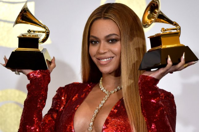 Beyonce appears backstage with her awards for Best Music Video for Formation and Best Urban Contemporary Album for Lemonade during the 59th annual Grammy Awards on February 12.The names of Beyonce's newborn twins have been announced on Instagram. File Photo by Christine Chew/UPI