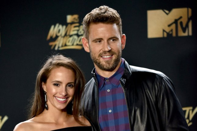 Nick Viall (R) and Vanessa Grimaldi attend the MTV Movie & TV Awards on May 7. The pair both broke their silence Monday after announcing last week that they ended their engagement. File Photo by Christine Chew/UPI