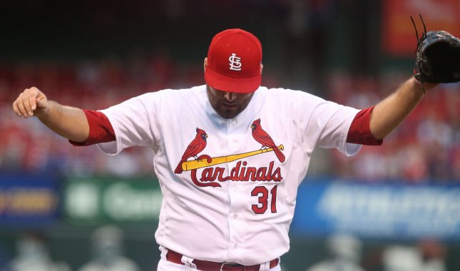 St. Louis Cardinals pitcher Lance Lynn throws up his arms after getting the third out in the first inning against the Chicago Cubs on Thursday. Photo by Bill Greenblatt/UPI