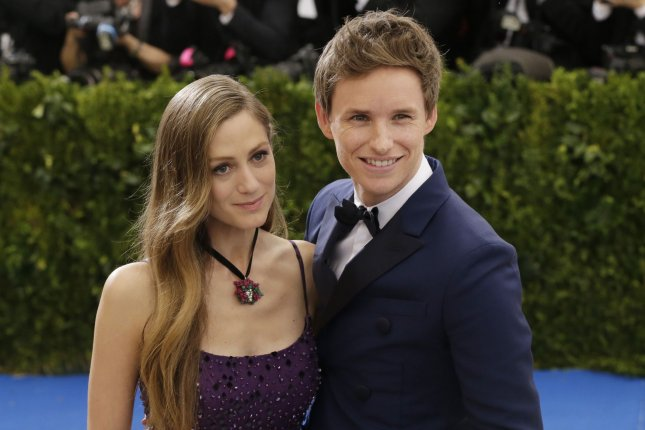 Eddie Redmayne (R), pictured with Hannah Redmayne, plays Newt Scamander in the Fantastic Beasts movies. File Photo by John Angelillo/UPI