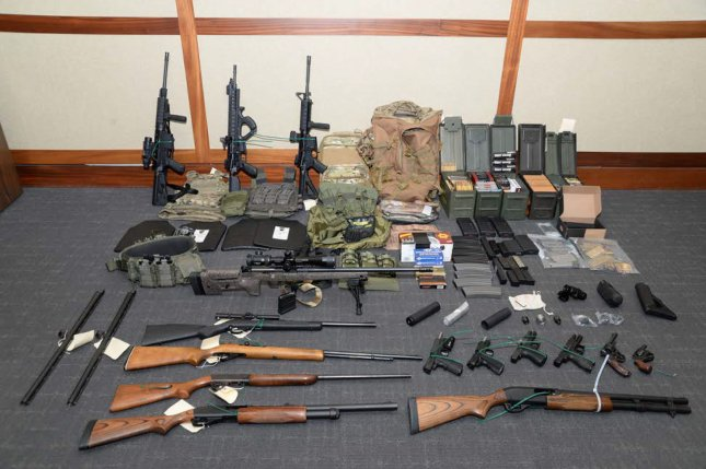 A cache of weapons, including 15 firearms and more than 1,000 rounds of ammunition, were found in the Silver Spring, Md., home of Lt. Christopher Paul Hasson of the U.S. Coast Guard on February 15. File Photo courtesy U.S. Attorney's Office for the District of Maryland