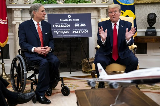 President Donald Trump meets with Texas Gov. Greg Abbott in the Oval Office of the White House on Thursday. Pool Photo by Doug Mills/UPI