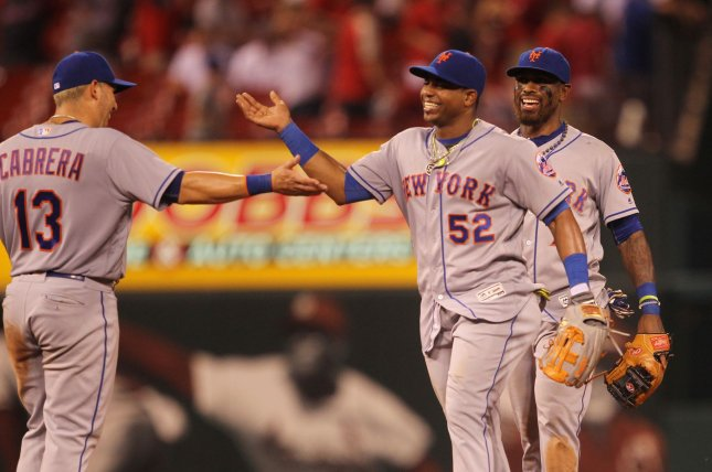 New York Mets' Jose Reyes (R) and Yoenis Caspedes celebrate their 10-6 win over the St. Louis Cardinals with Asdrubal Cabrera at Busch Stadium in St. Louis on August 25, 2016. Photo by Bill Greenblatt/UPI