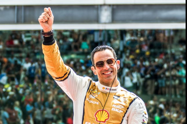 Helio Castroneves waves to the crowd during introductions for the 2017 Indianapolis 500. Photo by Edwin Locke/UPI