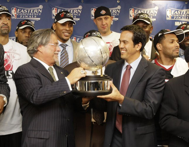 Miami Heat owner Micky Arison (L) and head coach Eirk Spoelstra hold the NBA Eastern Conference trophy after defeating the Chicago Bulls in game 5 of the series at the United Center in Chicago on May 26, 2011. The Heat won the game 83-80 and the series 4-1. The Heat will face the Dallas Mavericks in the to NBA finals. UPI/Nam Y. Huh/Pool