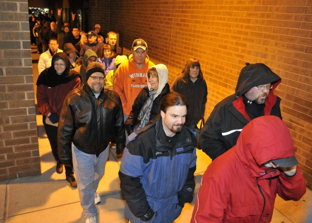 Shoppers file in at 6am to an Office Depot store hoping to get door buster deals on November 26, 2010 in Brookfield, Wisconsin. Retailers are hoping for good sales numbers on this year's Black Friday as the economy is showing signs of recovery. UPI/Brian Kersey