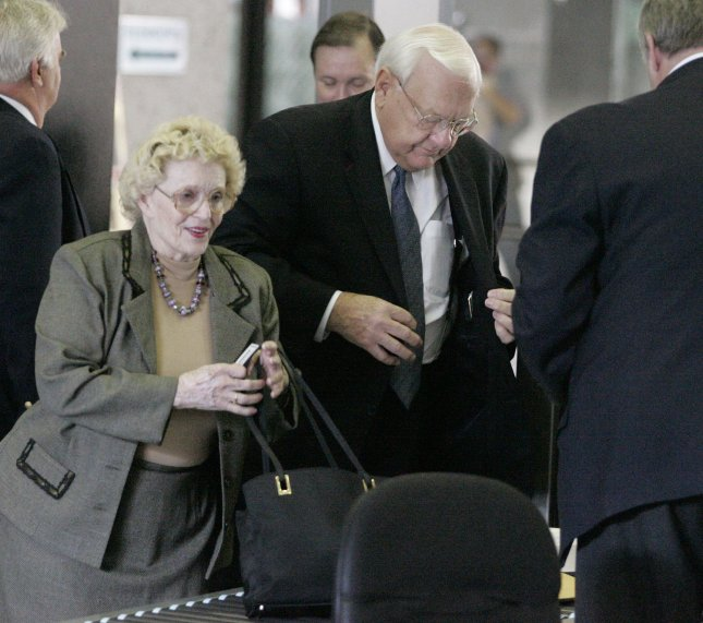 Former Illinois Gov. George Ryan, right, and his wife Lura Lynn arrive in court where the former governor is facing federal corruption charges, Sept. 28, 2005, in Chicago. Opening arguments for Ryan's trial began Wednesday. (UPI Photo/Brian Kersey)