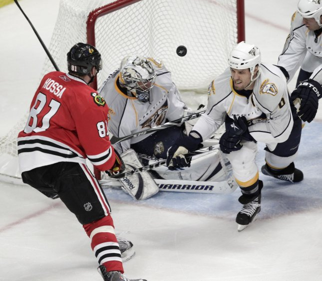Chicago Blackhawks right wing Marian Hossa (L) shoots as Nashville Predators goalie Pekka Rinne (C) and defenseman Shea Weber defend during Game 2 of the Western Conference quarterfinals series at United Center in Chicago, April 18, 2010. UPI/Brian Kersey