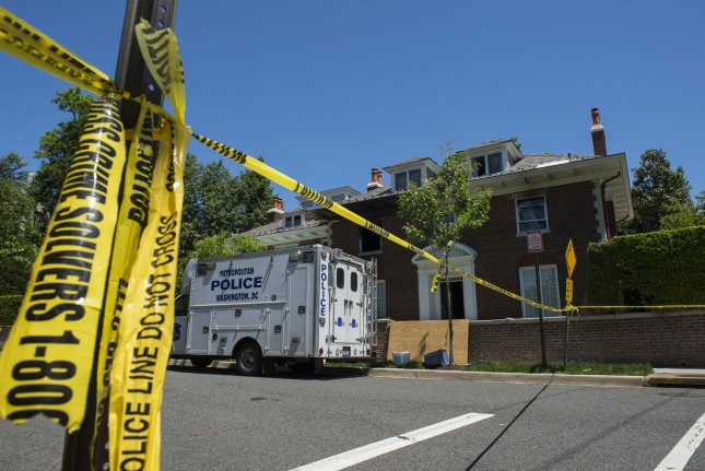 Police continue to inspect the $5 million house in the fashionable Northwest district of Washington, DC on May 23, 2015, where four people were brutally murdered after an apparent ransom was paid on May 14, 2015. Police say captured suspect Daron Dylon Wint appeared to have accomplices in the murder of Savvas Savopoulos, his wife Amy, son Philip and housekeeper Veralicia Figueroa. The lead on Wint apparently came from his DNA on a pizza crust. Photo by Pat Benic/UPI