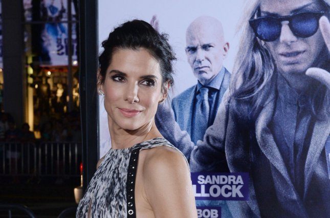 Cast member Sandra Bullock attends the premiere of the motion picture dramatic comedy Our Brand Is Crisis at the TCL Chinese Theatre in the Hollywood section of Los Angeles on Oct. 26, 2015. Storyline: An American woman, well-versed in political campaigns, is sent to the war-torn lands of South America to help install a new leader but is threatened to be thwarted by a long-term rival. Photo by Jim Ruymen/UPI
