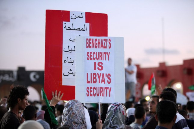 Libyan protesters holding placards during a march in Benghazi, Libya, 22 September 2012. Hundreds of Libyan protesters forced members of a hardline Islamist militia out of their base in the second city of Benghazi, setting fire to and wrecking the military compound. File photo by Tariq AL-hun/UPI
