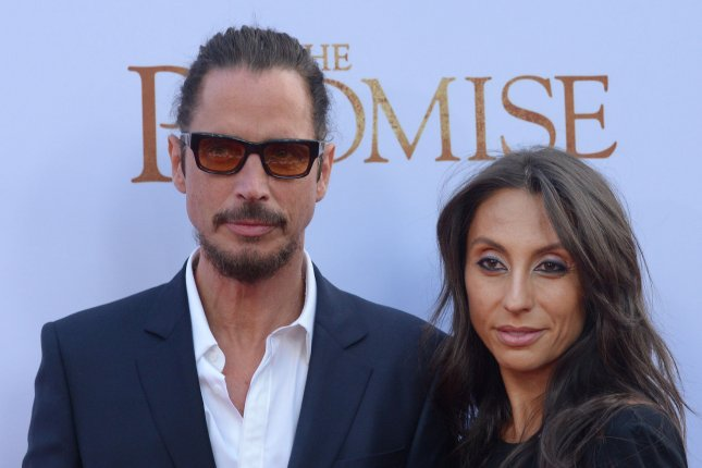 Soundgarden singer Chris Cornell and his wife Vicky Karayiannis attend the The Promise premiere in Los Angeles on April 12, 2017. A medical examiner has determined that Cornell committed suicide. Cornell died Wednesday night in Detroit. The Wayne County Medical Examiner's office determined the cause of death was hanging. He was 52. File Photo by Jim Ruymen/UPI