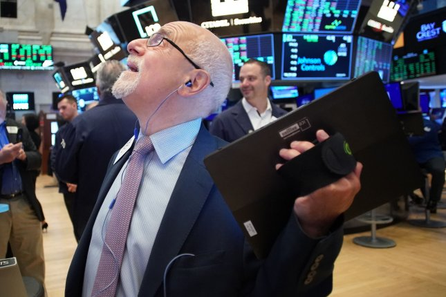 A trader gazes upward Friday on the the floor of the New York Stock Exchange on Wall Street in New York City. Photo by John Angelillo/UPI