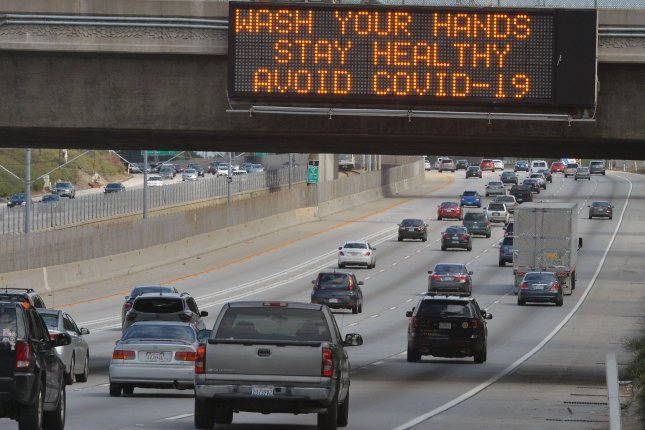 A coronavirus health advisory is displayed on Interstate 105 in Los Angeles on Sunday. Photo by Jim Ruymen/UPI