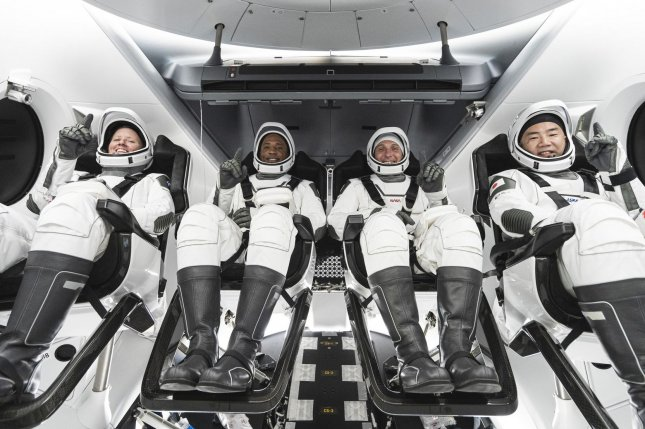 NASA's SpaceX Crew-1 astronauts are pictured seated in the company's Crew Dragon spacecraft during training for launch in Florida on Oct. 31: Shannon Walker, mission specialist; Victor Glover, pilot; and Mike Hopkins, Crew Dragon commander; and Japanese astronaut Soichi Noguchi, mission specialist. Photo courtesy of SpaceX