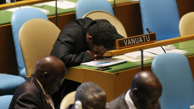 A delegate from the country of Vanuatu takes a nap as heads of state speak at the 66th session of the United Nations General Assembly at the UN in a 2011 file photo. UPI/Monika Graff