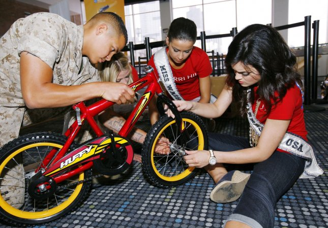 Most kids injured on a bike did not wear a helmet Marine Blake Johnson of Redding, PA, helps out Miss USA contestants Angelina Kayyalaynen, center, of Washington and Brittany Lee Thelemann of Minnesota assemble a bicycle during the USO Build a Bike event where bikes are assemble and donated to military families at Pier 88 in New York City. UPI /Monika Graff.