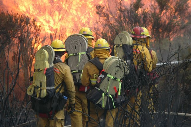 Firefighters battle a fast moving wildfire in California. (UPI Photo / Earl S. Cryer).