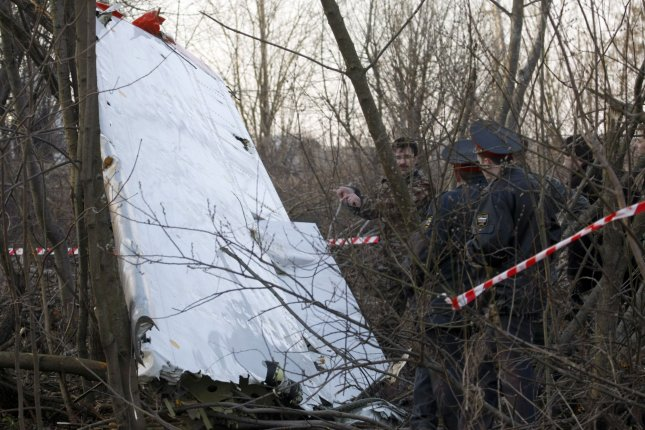 Wreckage of the plane crash site that killed Polish President Lech Kaczynski and 96 others is seen near Smolensk, in western Russia, on April 10, 2010. The plane, carrying his wife and high-ranking military and civilian leaders, crashed as it landed in thick fog. Polish prosecutors alleged Monday that a new analysis shows that two Russian air traffic controllers and a third Russian official in the control tower deliberately contributed to the disaster. File photo by Alex Natin/UPI