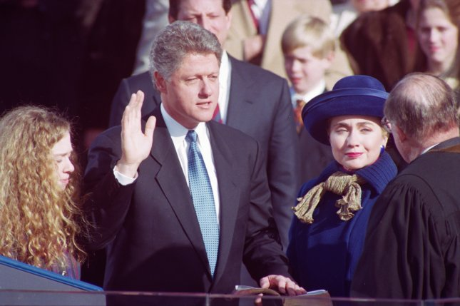 William Jefferson Clinton, flanked by his daughter, Chelsea Clinton, and wife, Hillary Rodham Clinton, is sworn in as president of the United States on January 20, 1993 on Capitol Hill. On November 3, 1992, U.S. voters elected Democrat Bill Clinton, the governor of Arkansas, to be president over incumbent George H.W. Bush. UPI File Photo