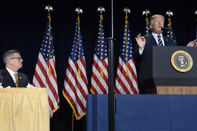 President Donald Trump remarks as Illinois Rep. Randy Hultgren listens during the National Prayer Breakfast at the Washington, D.C., Hilton Hotel on Thursday. Photo by Mike Theiler/UPI