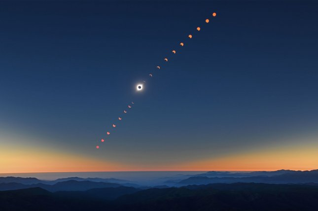 A composite image of the phases of a Total Solar Eclipse at the AURA Cerro Tololo Observatory near La Serena, Chile on Tuesday. The rare event occurs as the moon's orbit places it directly in front of the sun. Totality darkened the skies over the mountainous region for approximately two minutes and six seconds. Photo by Joe Marino/UPI