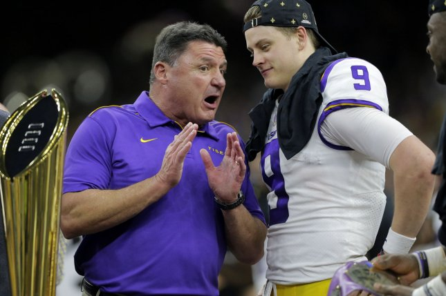 LSU football coach Ed Orgeron (L) said former Tigers quarterback Joe Burrow (R) can use his work ethic and leadership skills to turn the Cincinnati Bengals into a Super Bowl contender. File Photo by AJ Sisco/UPI