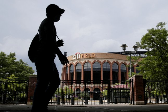 A man walks by the front entrance to Citi Field, home of the New York Mets, in the Queens borough of New York City on June 5. File Photo by John Angelillo/UPI
