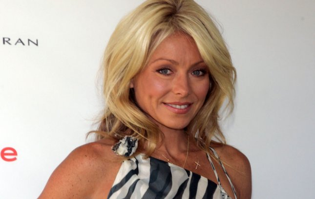 Kelly Ripa arrives for the Super Saturday 14 in Water Mill, New York on July 30, 2011. UPI /Laura Cavanaugh