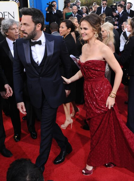 Actor and director Ben Affleck and his wife, actress Jennifer Garner, arrive for the 70th annual Golden Globe Awards held at the Beverly Hilton Hotel on Jan. 13, 2013. UPI/Jim Ruymen