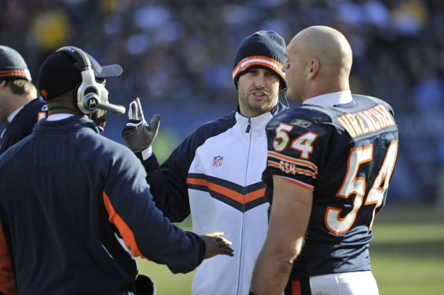 Injured Chicago Bears quarterback Jay Cutler (C) talks with middle linebacker Brian Urlacher (54) and head coach Lovie Smith during the second quarter against the Seattle Seahawks at Soldier Field on December 18, 2011 in Chicago. The Seahawks won 38-14. UPI/Brian Kersey