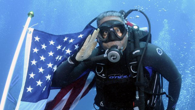 Congressman Allen West (R. Fla), salutes the American flag on the wreck of the Ancient Mariner in the waters off Pompano Beach, Fla. on June 12, 2011. .UPI/Joe Marino