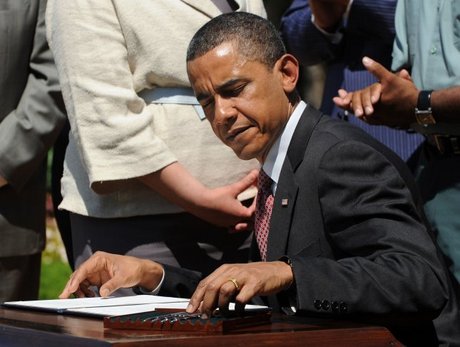 U.S. President Barack Obama signs a Presidential Memorandum outlining the next steps in his vision for cleaner, more efficient vehicles in the Rose Garden of the White House in Washington on May 21, 2010. UPI/Roger L. Wollenberg