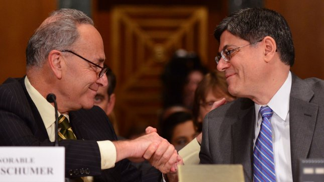 Former White House Chief of Staff Jacob Lew shakes hands with Sen. Charles Schumer (D-NY) after Schumer introduced him during his Senate Finance Committee confirmation hearing to be the next Tresury Secretary on February 13, 2013 in Washington, D.C. UPI/Kevin Dietsch