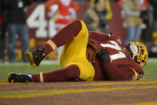Washington Redskins tackle Trent Williams is injured in the fourth quarter against the Philadelphia Eagles at FedEx field in Landover, Maryland on December 20, 2014. The Redskins defeated the Eagles 27-24. UPI/Kevin Dietsch