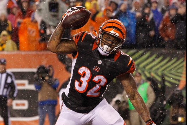 Cincinnati Bengals half back Jeremy Hill (32) celebrates after scoring a touchdown against the Pittsburgh Steelers during the second half of play in their NFL Wild Card Round game at Paul Brown Stadium in Cincinnati, Ohio, January 9, 2016. Photo by John Sommers II/UPI